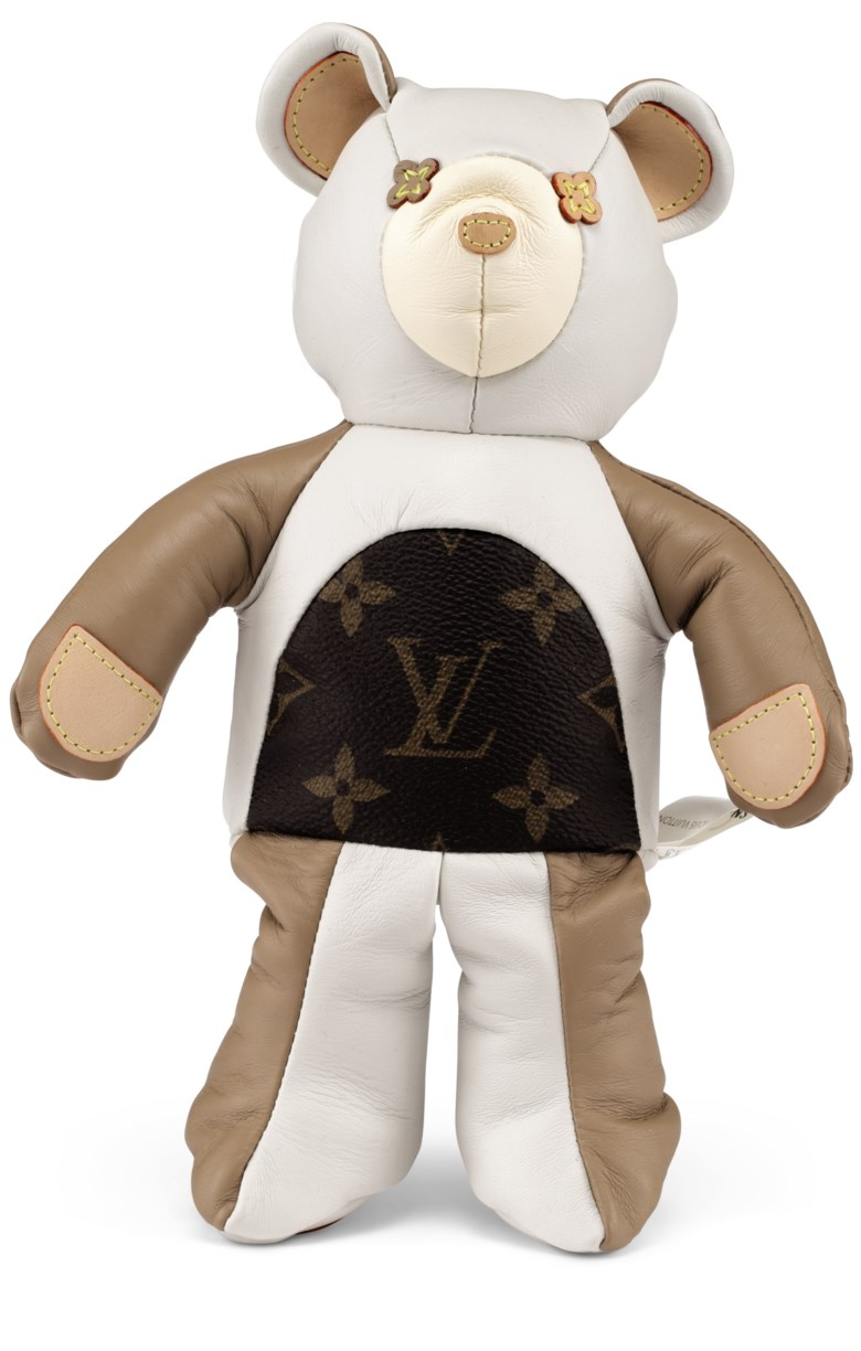 A calfskin, vvn leather & classic monogram canvas doudou teddy bear with yellow stitching, Louis Vuitton, 2017. 17.5 w x 25 h x 8 d cm. Estimate                    $700-900. Offered in Handbags & Accessories, 29 May to 19 June 2018, Online