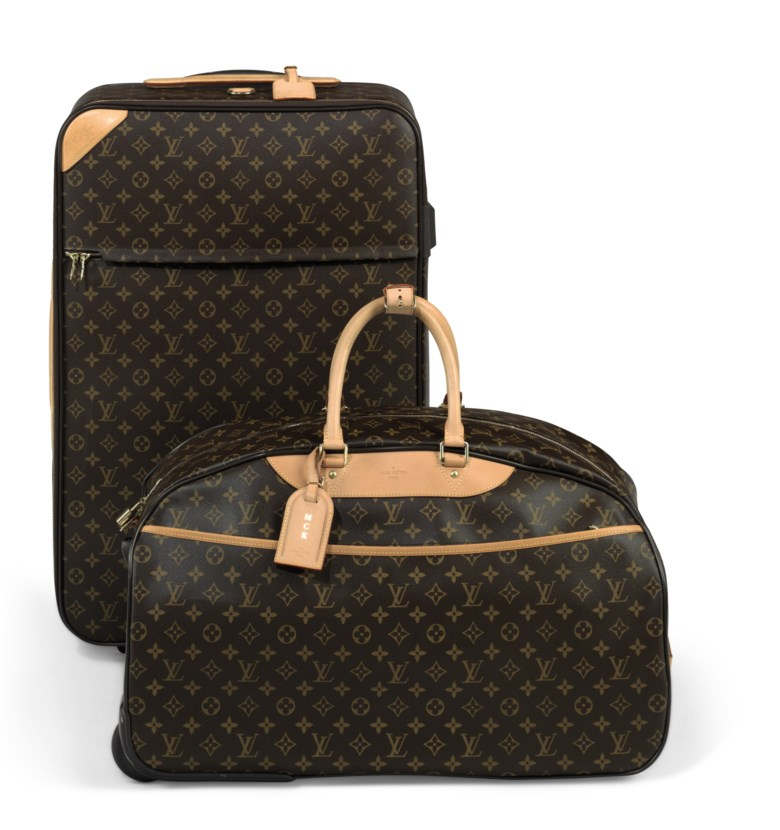 A classic monogram canvas pégase légère 60 with gold hardware a classic monogram canvas éole 70 with gold hardware, Louis Vuitton, 2004. 70 w x 42 h x 24 d cm. Estimate                    $1,000-1,500. Offered in Handbags & Accessories, 29 May to 19 June 2018, Online