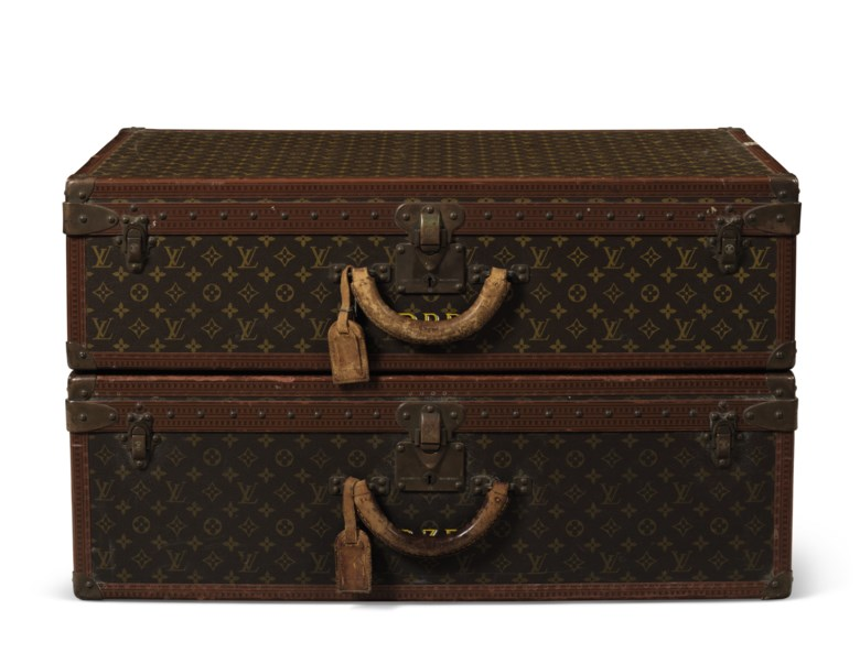 A set of two classic monogram canvas alzer 65 trunks with brass hardware, Louis Vuitton, circa 1980. 65 w x 23 h x 41 d cm. Estimate                    $1,500-2,400. Offered in Handbags & Accessories, 29 May to 19 June 2018, Online