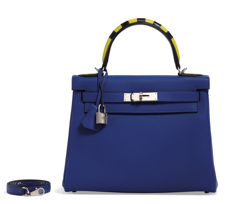 A limited edition Bleu Electrique, Indigo, Lime & Vert Foncé Togo, calf box and chèvre leather retourné Kelly au trot 28 with palladium hardware, Hermès, 2017. 28 w x 20 h x 11 d cm. Estimate $10,000-15,000. This lot is offered in  Handbags & Accessories, 20 November to 5 December 2018, Online