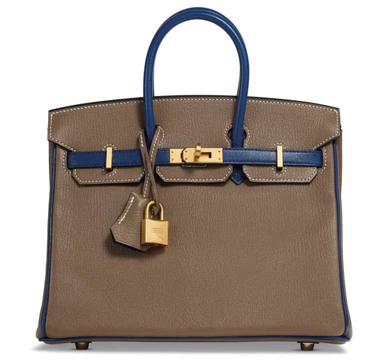 A custom Etoupe & Blue Sapphir Chèvre leather Birkin 25 with brushed gold hardware, Hermès, 2018. 25 w x 19 h x 14 d cm. Estimate $10,000-15,000. This lot is offered in  Handbags & Accessories, 20 November to 5 December 2018, Online