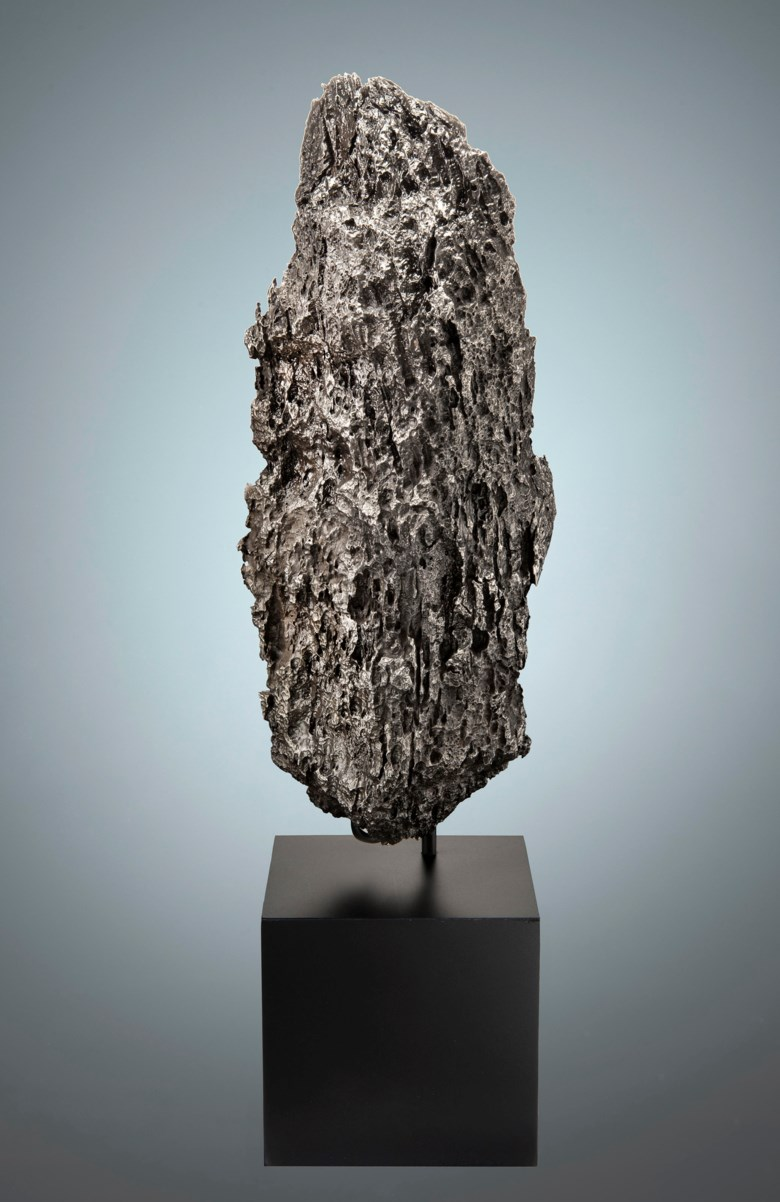 Exotic Dronino Meteorite — Extraterrestrial Monolithic Sculpture, Iron, ataxite (ungrouped) Ryazan district, Russia. 303 x 129 x 111mm (12 x 5 x 4⅓ in). Estimate                    $10,000-15,000. This lot is offered in Deep Impact Martian, Lunar and Other Rare Meteorites, 7-14 February 2018, Online